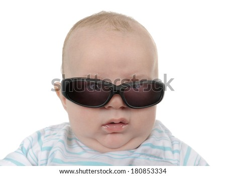 Baby with sunglasses getting angry - stock photo