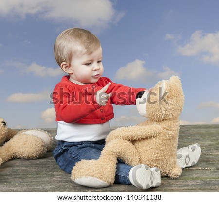 baby with teddy bear - stock photo