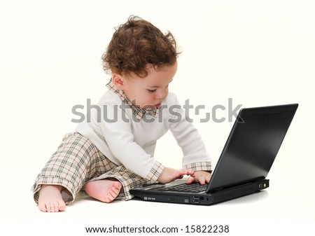 Baby working on a black laptop
