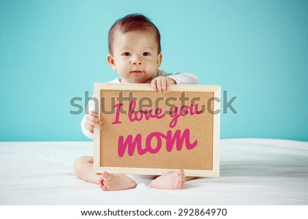 "Baby writing ""I Love you Mom"" on the board, new family concept, studio shot - stock photo"