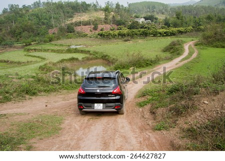 Bac Giang, Viet Nam - March 17, 2015: A SUV Peugeot 3008 car running on the mountain road in Vietnam