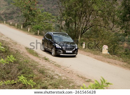 Bac Giang, Viet Nam - March 17, 2015: A SUV Peugeot 3008 car running on the road in Vietnam