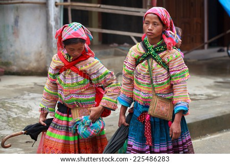 Bac Ha JUL 08: Two Flower Hmong woman at local Sunday market on July 8, 2012 in Bac Ha, Vietnam. Flower Hmongs are the biggest ethnic group in Bac Ha area,their name comes from their colorful costumes