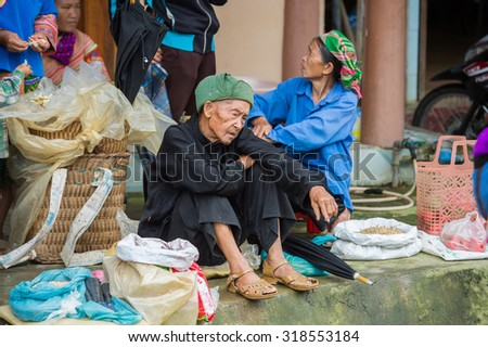 BAC HA, VIETNAM - SEP 21, 2014: Unidentified Vietnamese man at the Bac Ha Market, a large Sunday market with people wearing beautiful colored minorities costumes