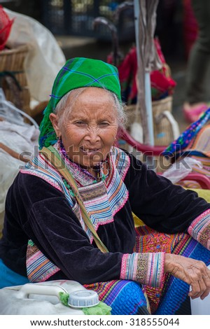 BAC HA, VIETNAM - SEP 21, 2014: Unidentified Vietnamese woman at the Bac Ha Market, a large Sunday market with people wearing beautiful colored minorities costumes