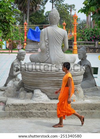 BAC LIEU, VIETNAM - DEC 11, 2014: Unidentified young monk at a Khmer pagoda in Mekong Delta, Vietnam. Theravada Buddhism arrived from India into the southern Vietnam between 300-600 AD. - stock photo