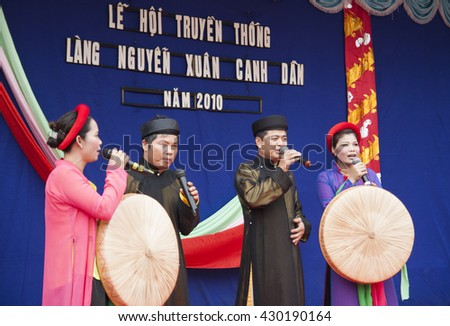 Bac Ninh, Vietnam - Mar 24, 2010: Vietnamese popular civilian artist in traditional costume singing traditional melody called Quan Ho Bac Ninh in occasion of a local folk free entrance festival day.