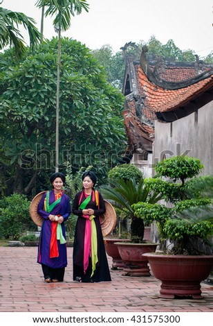 BAC Ninh, Vietnam, May 4, 2016 Two young girls, wearing traditional costumes, ancient temples roam, rural Bac Ninh, Vietnam