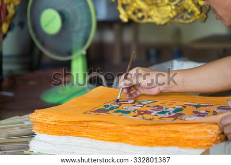 Bac Ninh, Vietnam - Sep 9, 2015: Painting is being made in workshop by craftsman in Dong Ho folk painting village
