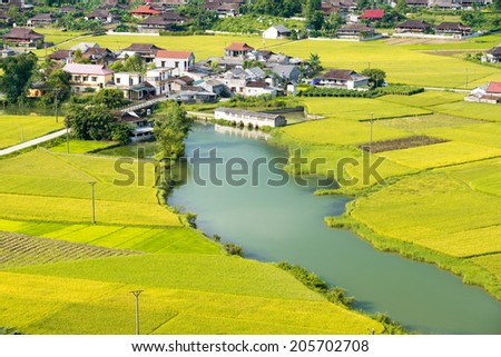 BAC SON, VIETNAM - JULY 11: Aerial view of  residential area on July 11, 2014 in Bac Son, a small district in Lang Son, Vietnam where the main career of the local people is agriculture. - stock photo