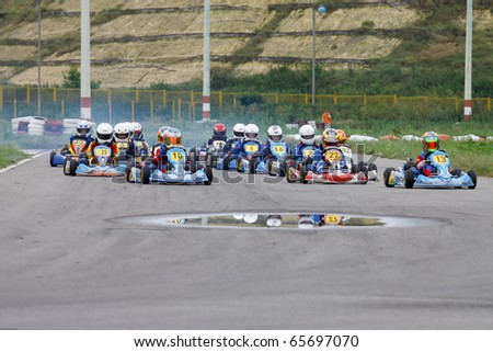 BACAU, ROMANIA - JUL 11: Andrei Vajda number 27 competes in National Karting Championship, Round 4 , July 11, 2010, in Bacau, Romania