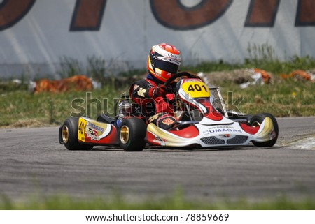 BACAU, ROMANIA - MAY 21: David Dugaesescu, number 401, competes in National Karting Championship, Round 2, on May 21, 2011 in Bacau, Romania.