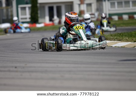 BACAU, ROMANIA - MAY 21: Kristopher Schlett, number 402, competes in National Karting Championship, Round 2, on May 21, 2011 in Bacau, Romania.