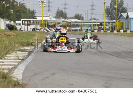 BACAU, ROMANIA - SEPTEMBER 4: David Dugaesescu, number 401, competes in National Karting Championship, Round 6, on September 4, 2011 in Bacau, Romania.
