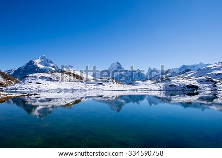 Bachalpsee and the snow peaks of Jungfrau region grindelwald switzerland - stock photo
