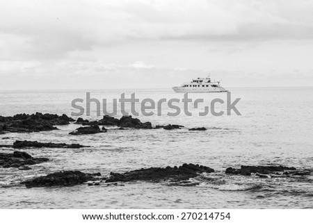 Bachas Beach has beautiful corners of sand and volcanic rock where many tourists arrive, Santa Cruz Island, Galapagos - stock photo