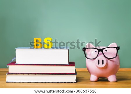 Bachelor of Science degree theme with textbooks and piggy bank and green chalkboard - stock photo