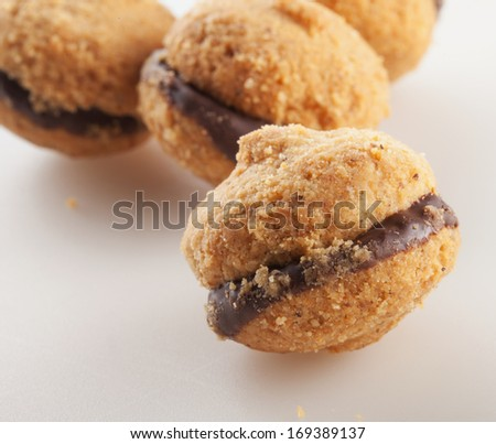 Baci di dama, typical Italian biscuits, over white background