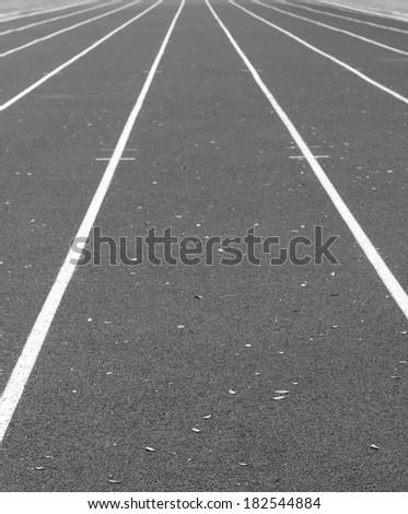 Back and White Close up on athletics track - stock photo
