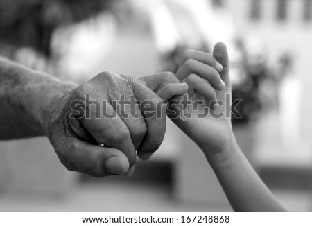 Back and White Hands of senior men in action  - stock photo
