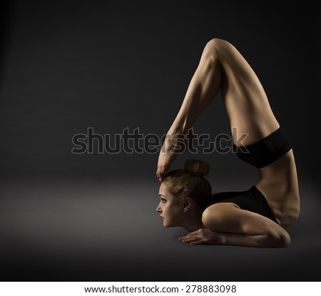Back Bending, Woman Bowing Stretch Arch, Gymnastics Acrobat in Backbend Exercising Pose - stock photo