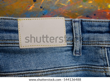 Back Blue jeans , and Color drop on wood, art abstract background