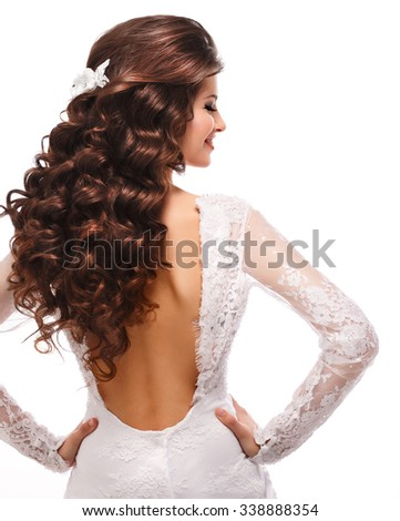 back brunette isolated on white.girl in white with long curly hair - stock photo