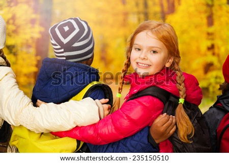 Back close up view of kids with arms on shoulders - stock photo