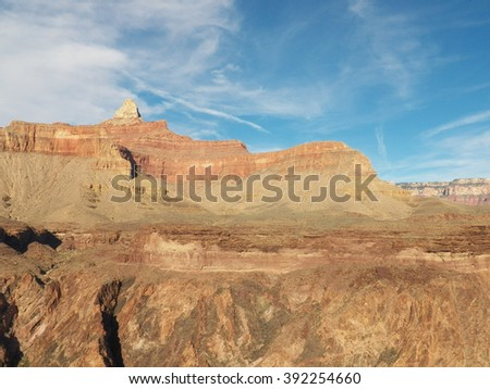 Back country hiking in the Grand Canyon, Arizona AZ, United States of America, USA. Dry desert landscape with rock cliffs and blue sky.