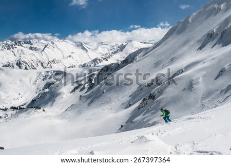 Back Country Skier in a Snowy Mountain Valley - stock photo