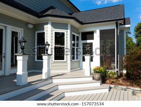Back deck and screen porch of the residential house - stock photo