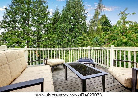Back deck with outdoor furniture and nice view. Comfortable beige sofa, ottoman and black coffee table. Northwest, USA