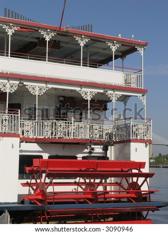 back end of Riverboat with red paddle wheel - stock photo