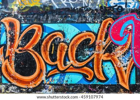 BACK - Graffiti on the wall. Beautiful abstract street art - stock photo