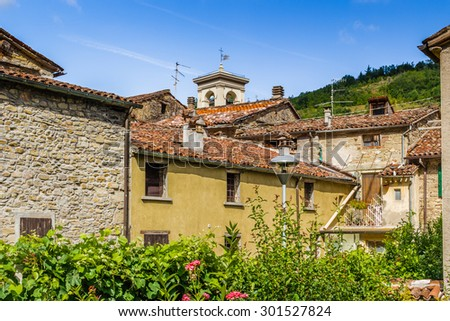 back in time and far from stress following the roofs of a typical small hill village in the countryside of Romagna in northern Italy - stock photo