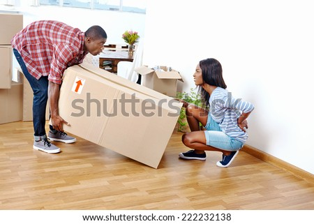 back injury from carrying a heavy moving box - stock photo