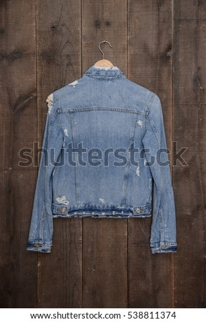 Back jeans jacket on a wooden background