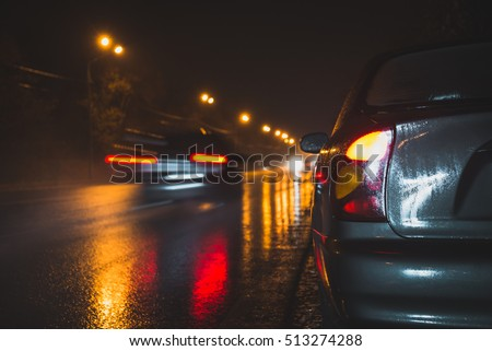 back light of a car on a raining road