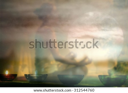 Back light of a woman exercising yoga at sunset with a warmth background - stock photo