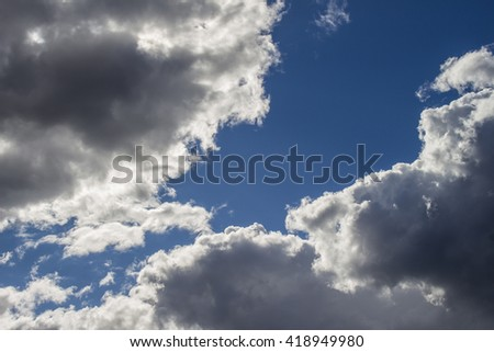 Back Lit Clouds on a Sunny Afternoon - stock photo