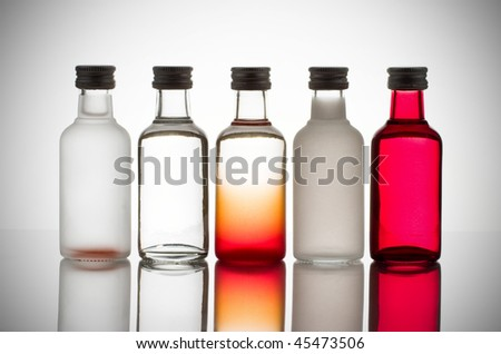 Back lit collection of colorful glass bottles - stock photo