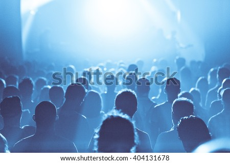 Back lit Crowd in silhouette during a Concert - stock photo