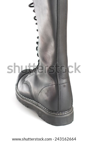 Back of a new tall lace-up knee-high black leather boot featuring 20 eyelets and steel-toes.  Fashion combat work boot worn by both men and women. - stock photo