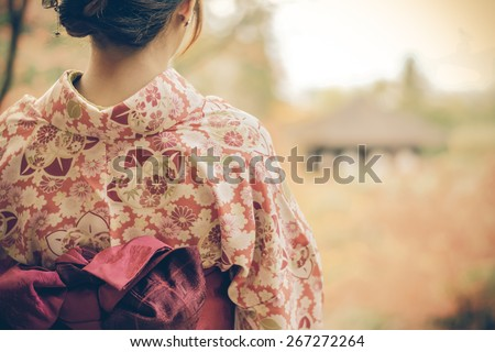 Back of a pretty Japanese girl in beautiful atmosphere in retro color. This picture has soft focus. - stock photo