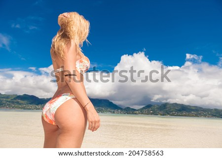 Sexy blonde on the beach