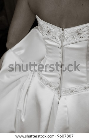 Back of a Wedding Dress Worn by a Bride - stock photo