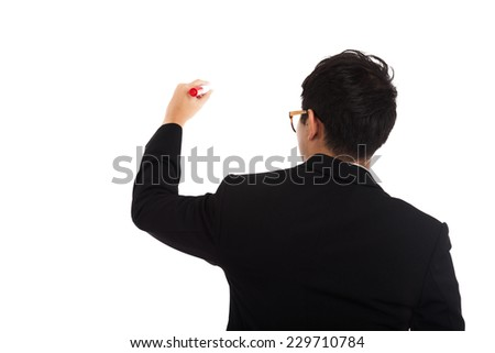 Back of Asian businessman write with red marker  isolated on white background