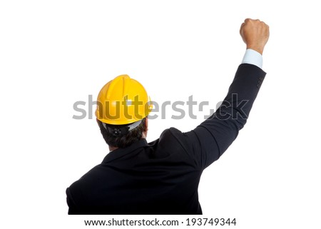Back of Asian engineer man rise his fist up for success  isolated on white background