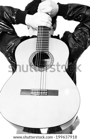 Back of Asian Musician hold his guitar, B&W processed and isolated - stock photo