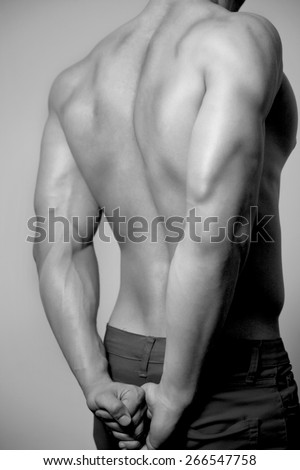 Back of Beautiful and health athletic caucasian muscular young man. Black-white photo. - stock photo